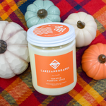 Lakes and Grapes Toasted Pumpkin Spice hand poured soy candle in glass container with metal lid.
