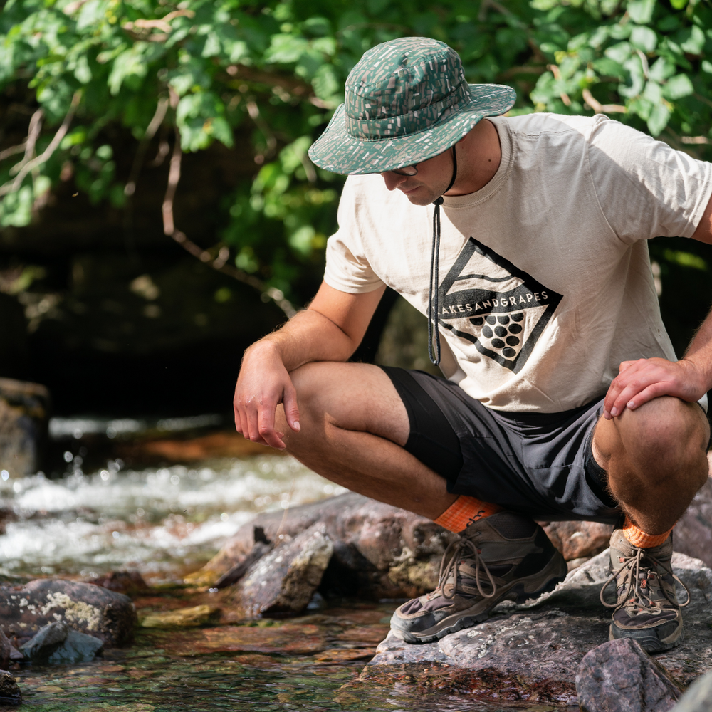 Explore the outdoors in a lightweight, comfortable, unisex Wave and Vine Tee- Tan by Lakes and Grapes