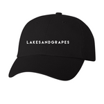 Lightweight and breathable, our classic black cap is the perfect accessory to rep Lakes and Grapes.