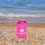 Pink Rosé by the Bay Koozie, Flamingo Towel, and Pink Noodle on the sandy beach in Traverse City