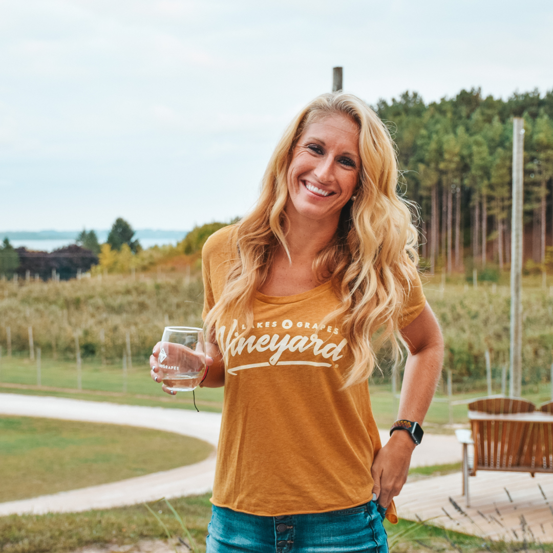 Wine Taste in Traverse City and wear the Women's Vineyard Scoop Tee- Gold by Lakes and Grapes
