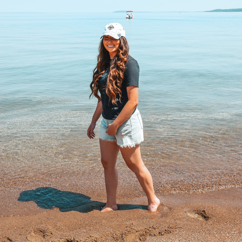 Beach day in Traverse City wearing the Lakes and Grapes Greyscale- Tie Die Hat