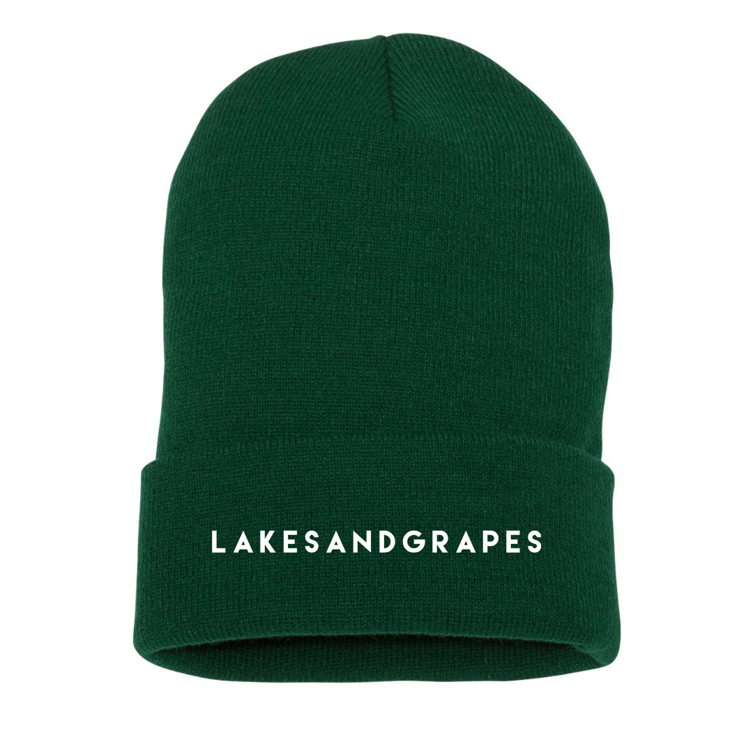 Lightweight and warm, this spruce Lakes and Grapes embroidered beanie is perfect for Michigan falls and winters by lake and in the woods.