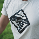 The comfortable Lakes and Grapes Wave and Vine Tee- Tan is perfect for your outdoor adventures