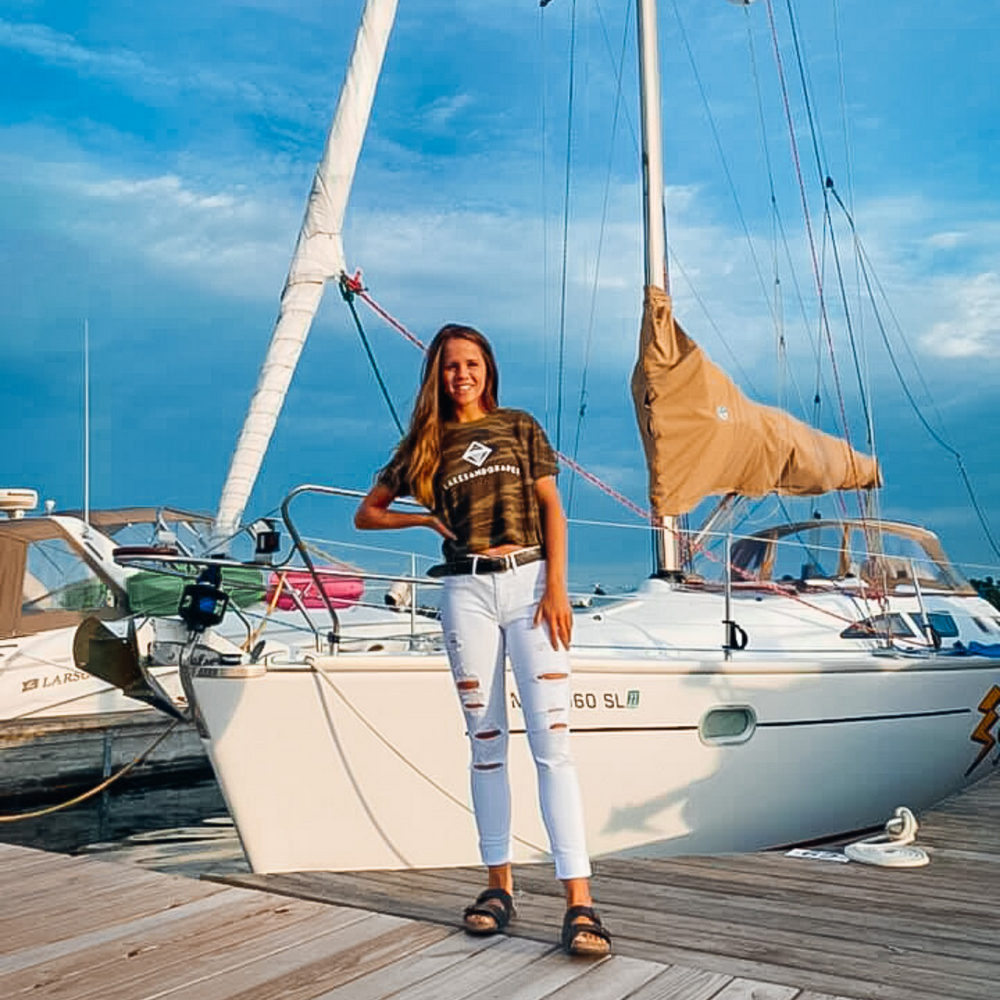 Wear the Lakes and Grapes Women's Classic Camo Crop Tee on your next boat day or sailing adventure
