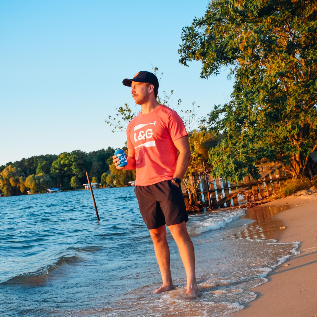 Hangout by the lake in the Lakes and Grapes Screw It! Paddle Tee- Red