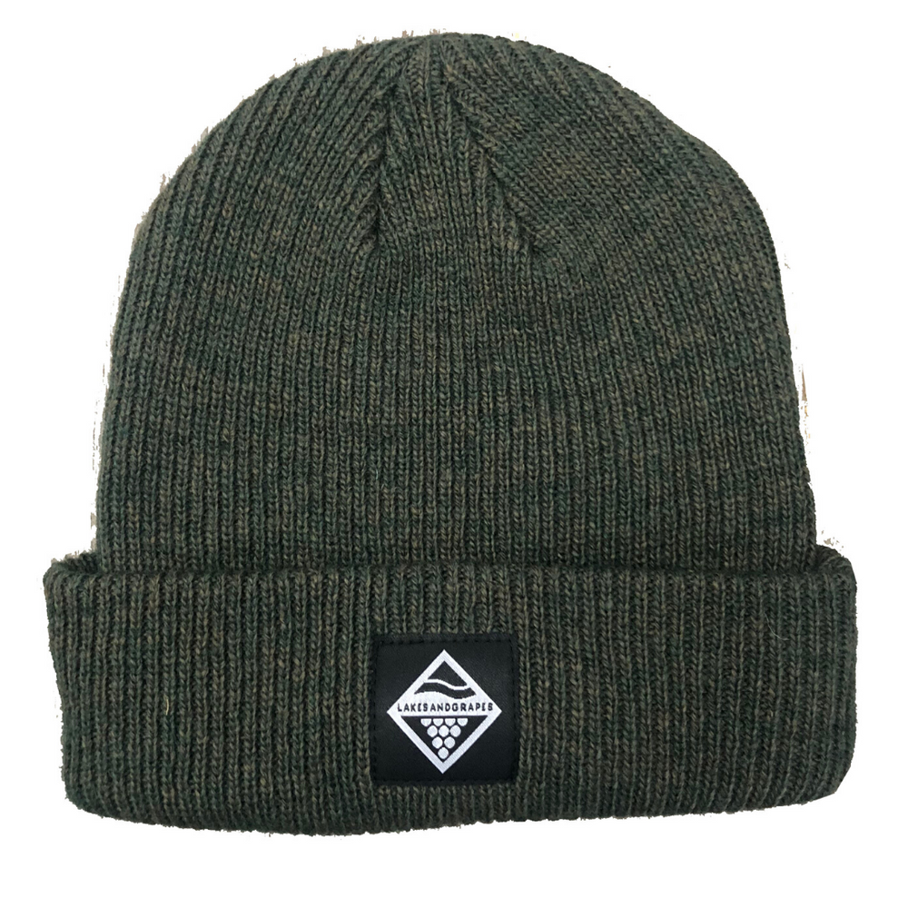 Lakes and Grapes merino wool beanie in forest green is perfect for cold Midwest winters.