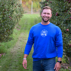 Lakes and Grapes royal Lifestyle Crew is perfect to wear in the Traverse City vineyards.