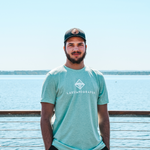 Lakes and Grapes classic logo heather mint tee is soft, comfortable, and ready for lake days.