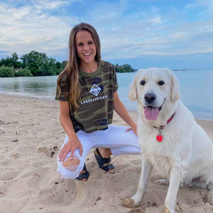 Load image into Gallery viewer, Walk the beach in Traverse City while wearing the Lakes and Grapes Women's Classic Camo Crop Tee