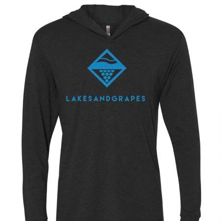 Lakes and Grapes long sleeve hooded tee offers the perfect amount of warmth without being too heavy so you can wear it on the windy boat on the Traverse City Bay or walking on the lake shore. The blue lettering and main logo make for a perfect Northern Michigan look, effortless and cool.