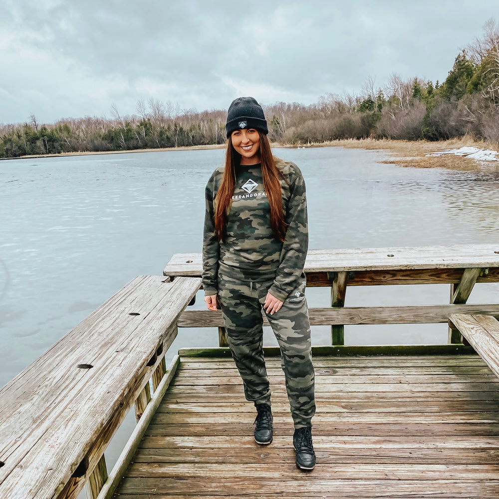 Outdoor adventuring in Michigan wearing the comfortable Lakes and Grapes Unisex Camo Joggers