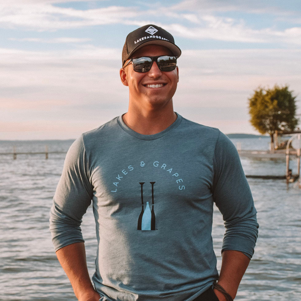 Lakes and Grapes heather slate long sleeve tee has a pop of color with the black and electric blue paddle logo on the front for that chilly summer mornings and late nights around the bonfire.