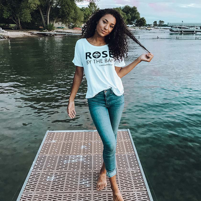 Lakes and Grapes presents Rosé by the Bay in a flowy fit tee that dresses up any casual outfit perfectly for a day in the Traverse City vineyards.