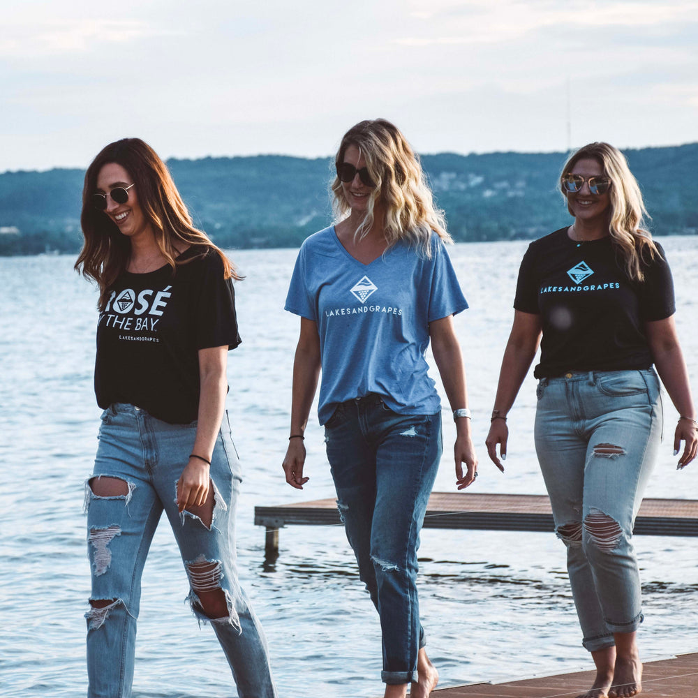 Lakes and Grapes presents Rosé by the Bay in a flowy fit tee with the phrase that says you're all about the life in the Traverse City vineyards.