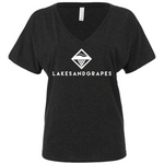 Lakes and Grapes charcoal women's v-neck short sleeve tee with white lettering accompanied by the logo. This charcoal v-neck shirt fits in perfectly whether you're on the boat all day or around downtown Traverse City.
