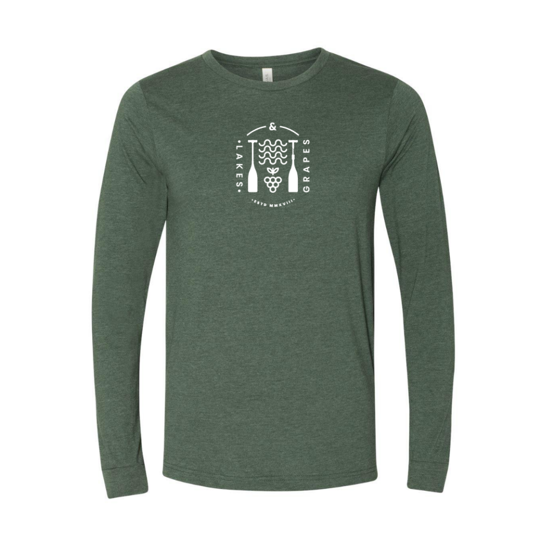 Lakes and Grapes lifestyle long sleeve tee in forest with white waves and grapes paddle logo.