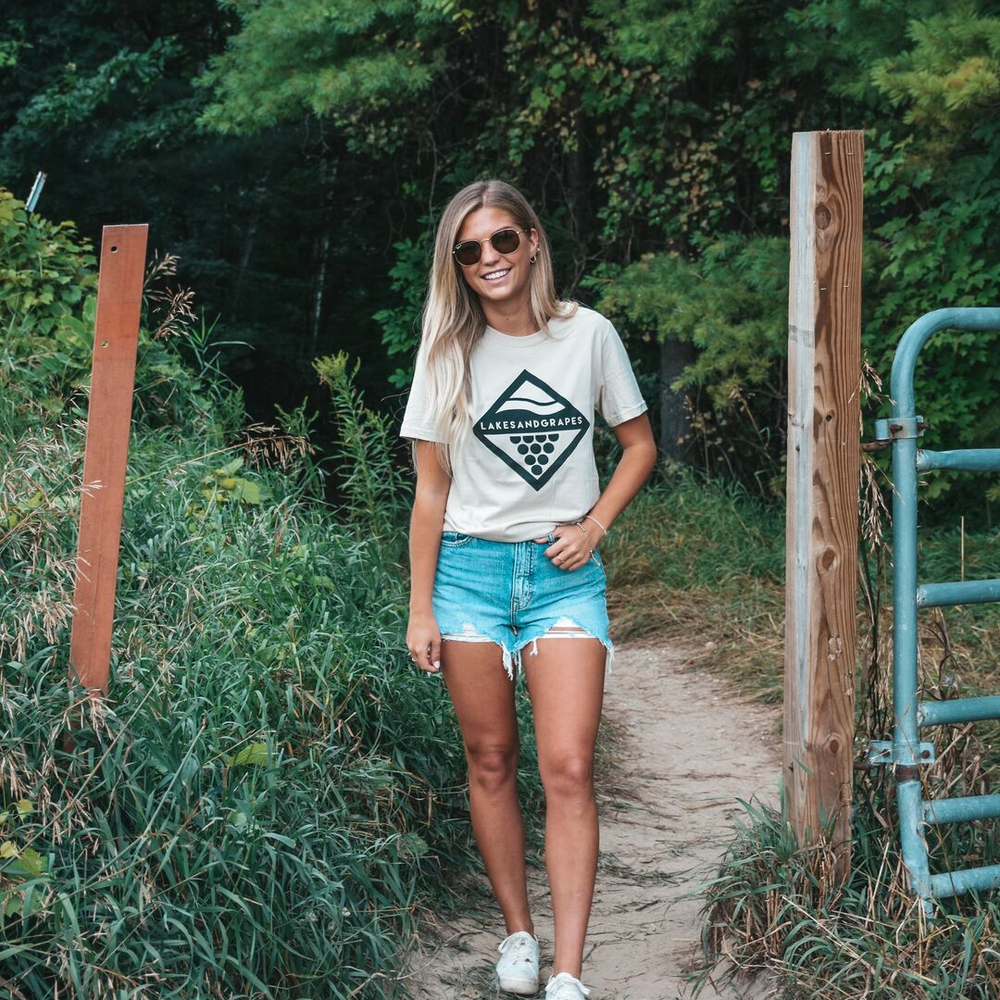 Explore the trails in Empire Michigan wearing the comfortable Wave and Vine Tee- Tan by Lakes and Grapes