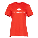 The Lakes and Grapes Women's Classic Tee-Poppy can be styled year-round as a pop of color