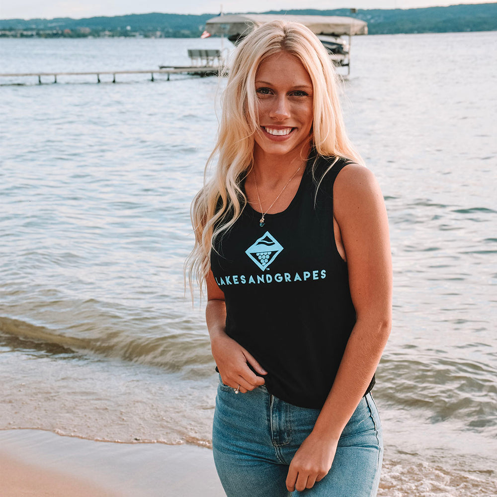 Lakes and Grapes flowy tank top in solid black with electric blue lettering under the main lakes and grapes logo is perfect for summer. Layer it with a jacket or leggings