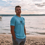 Lakes and Grapes electric blue logo tee is comfortable and versatile. This tee was made for Traverse City lake life with the Lake and Grapes and the logo printed in black.