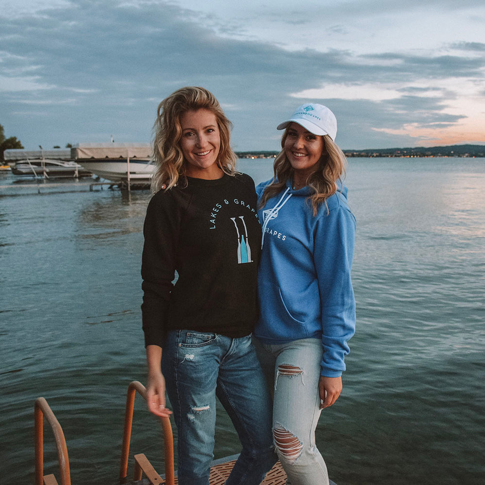 Lakes and Grapes crew neck style hoodie is perfect for layering. The paddle logo says you're all about what Traverse City & Northern Michigan is known for- wine and good times.
