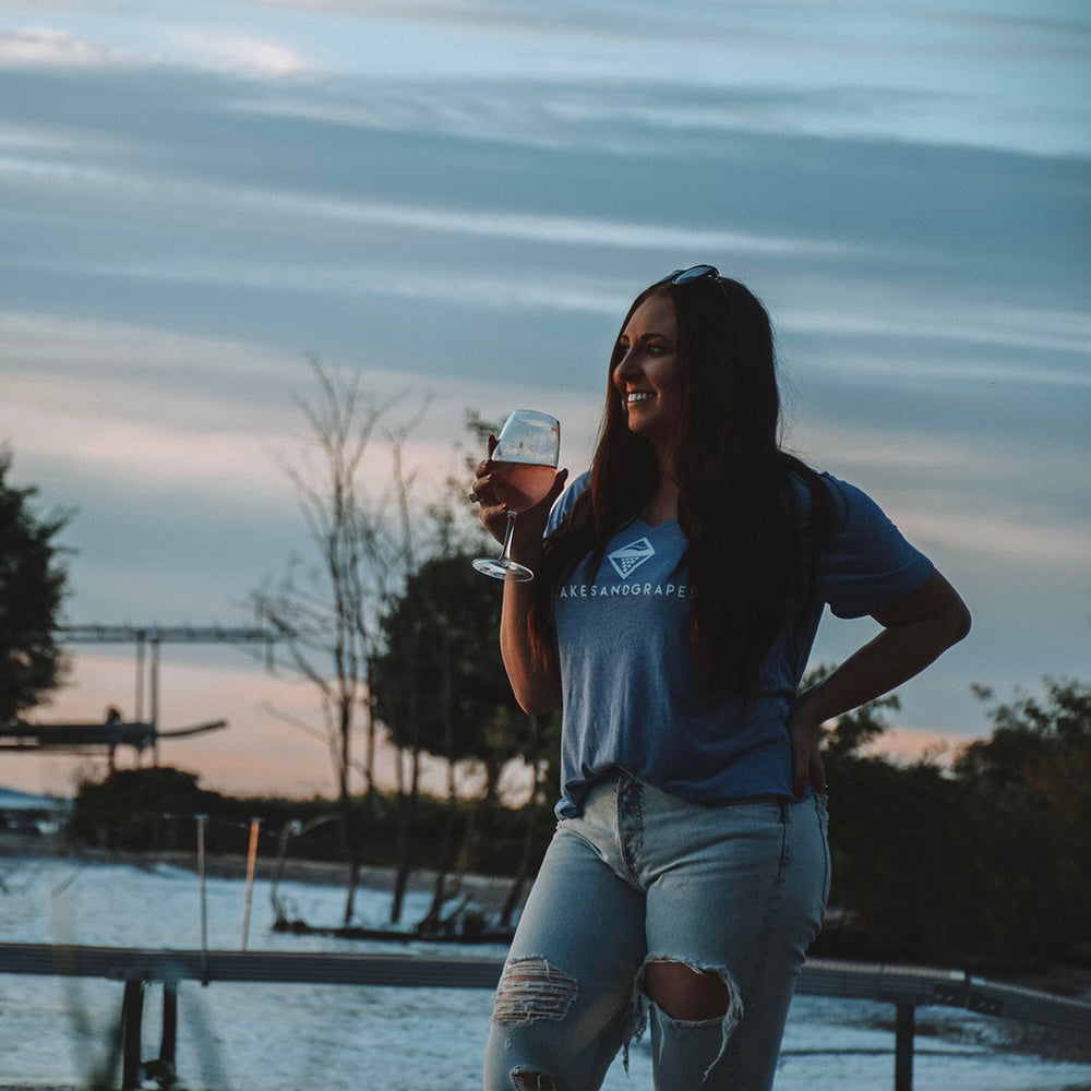 Lakes and Grapes deep v-neck tee in blue with white lettering is perfect for any occasion and pairs with any bottoms. Wear out with friends around Traverse City or on the wine tour.