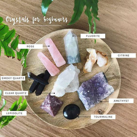 Assortment of crystals on a wooden plate