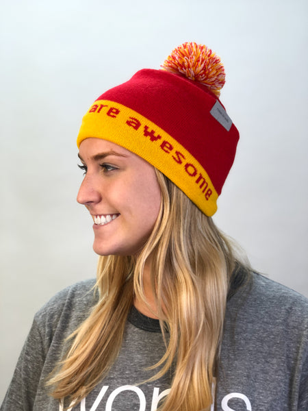 knit beanie I believe™ outside and we are awesome™ inside - red/gold/white w/pom