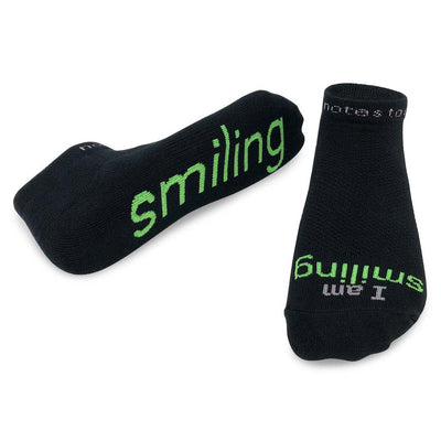 i am smiling black socks with positive message