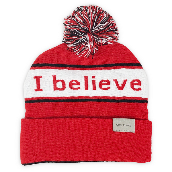 i believe beanie red with black and white pom