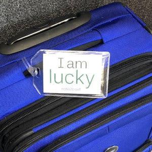 'I am lucky'™ + 'I am optimistic'™ luggage tag