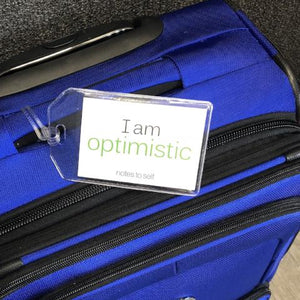 'I am optimistic'™ + 'I am smiling'™ luggage tag