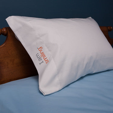 'I am smiling'™ positive affirmation pillowcase