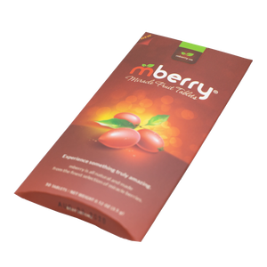 mberry Miracle Berry Tablets. Maroon with 3 miracle fruit on the front with yellow orange background. Logo has a red m and two green leaves above, followed by white letters that spell out berry.  The packaging is laying at a tilt, as if laying on a table