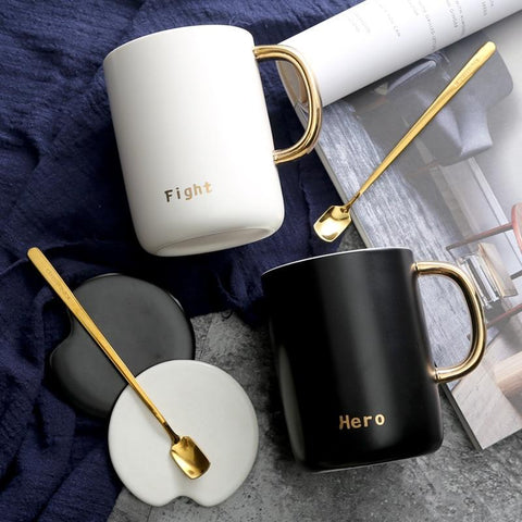 """Fight"", ""Hero"" and ""Glory"" Gold-Handled Mugs with Lid and Spoon -  www.sanroccoitalia.it - Mugs"