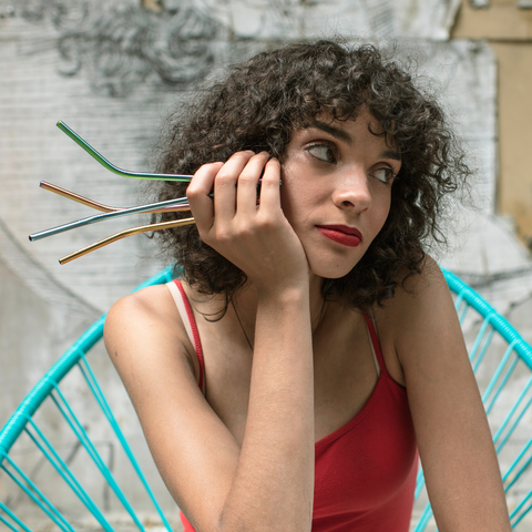 woman with reusable straws