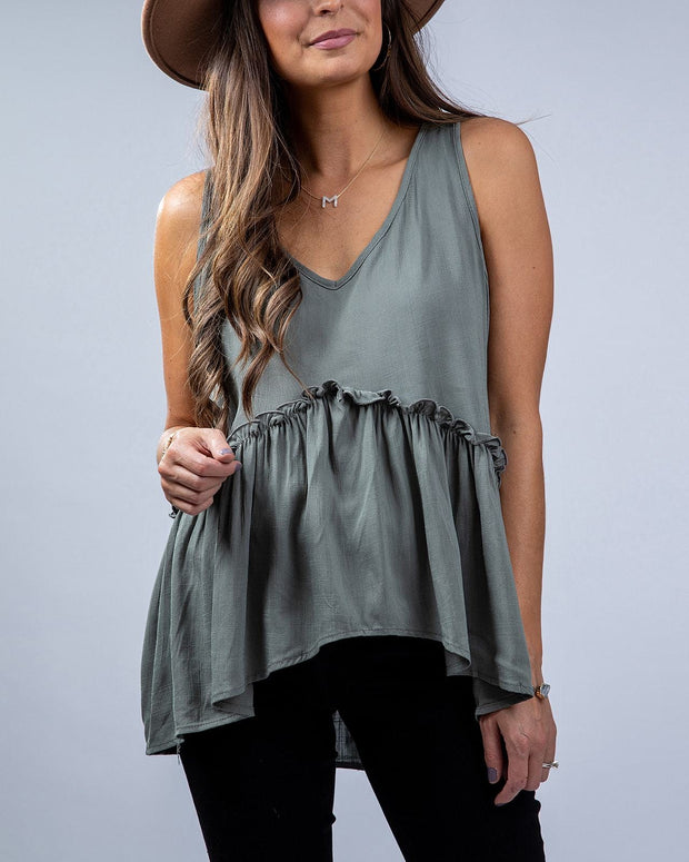 SIMPLY DARLINGS X LINC BOUTIQUE Evergreen Peplum Top