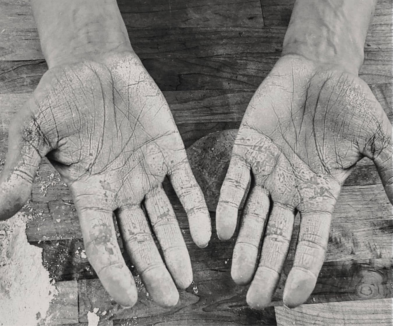 Image of bakers hands covered in flour from making bread