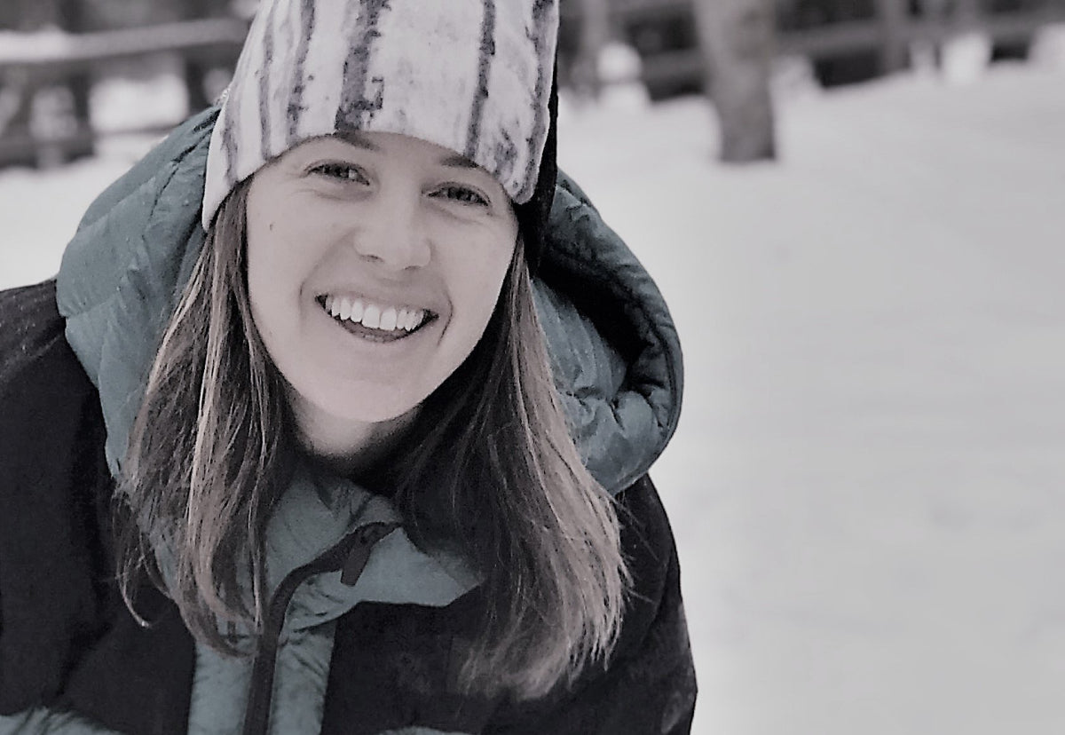 Ingrid Backstrom, big mountain skier.  Pictured in the snow smiling.
