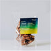 Almond Coconut and Lemon Mountain Bits granola package. Clear bag with granola filling to the top. Bright green, yellow an blue on packaging