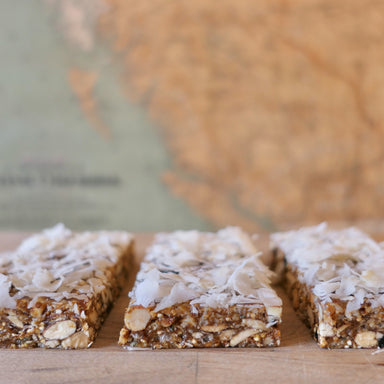 Almonds Coconut and Lemon Mountain Bites energy bar close up image with rustic almonds and large flakes of coconut