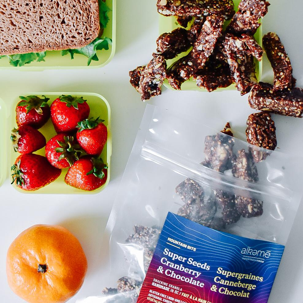 Waste free healthy school lunch with Super Seed Mountain Bits, Gluten Free Alkeme sandwich strawberries and orange