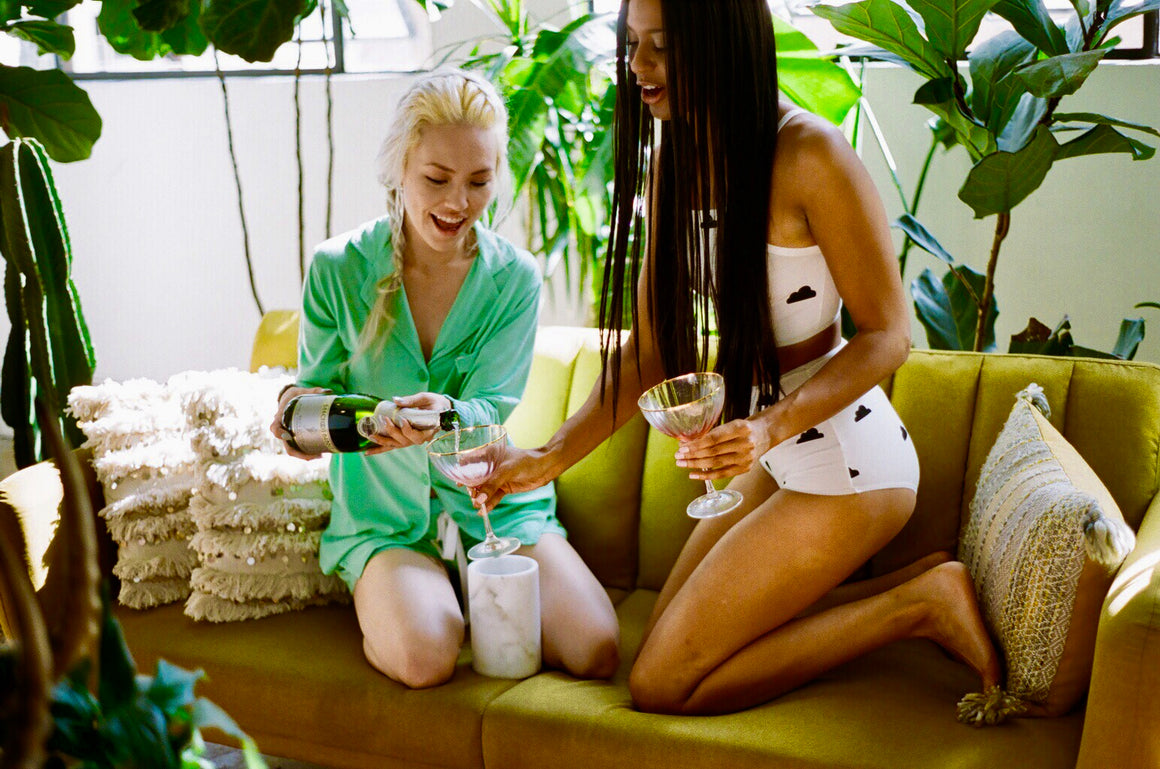 girls drinking champagne in pajamas