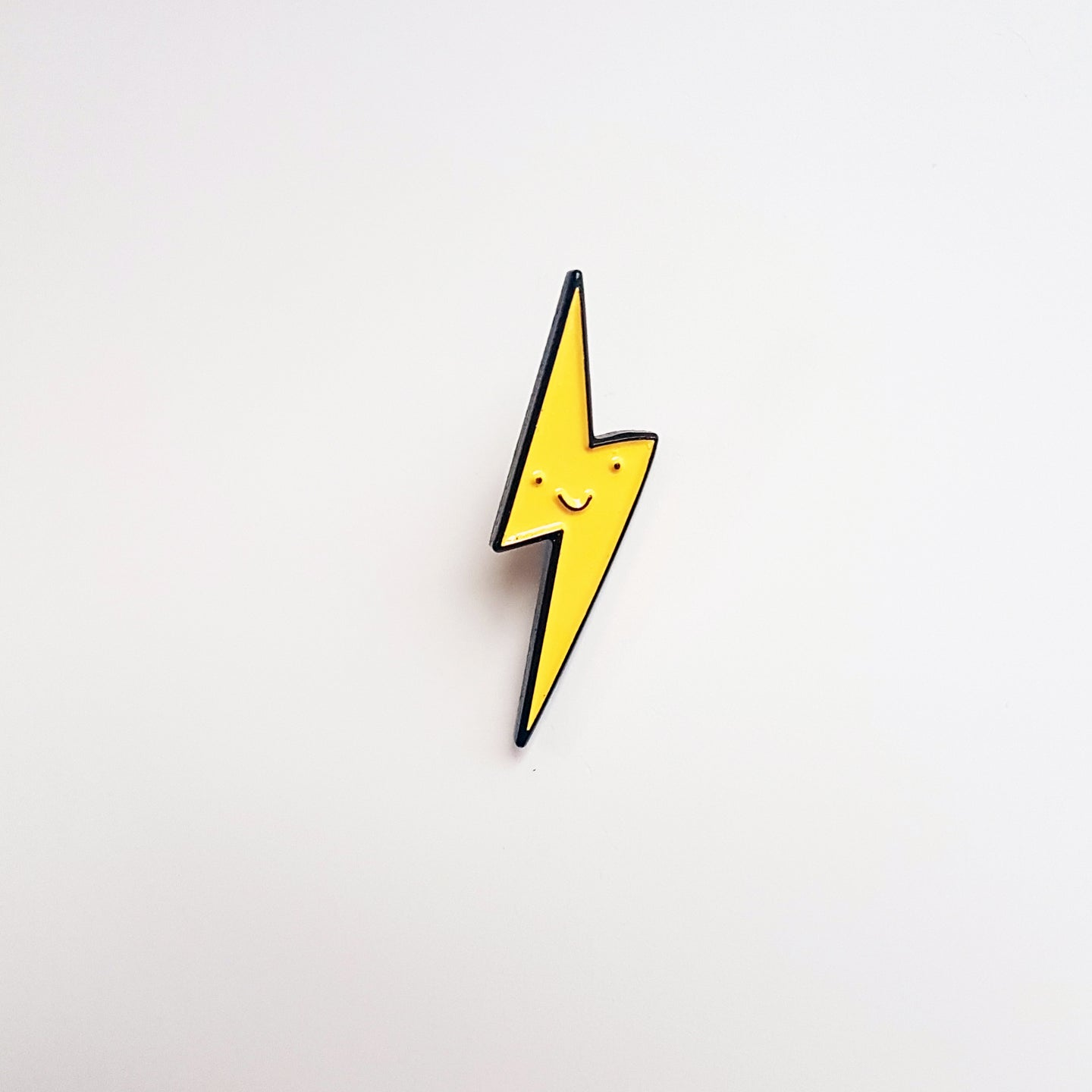 ELECTRIC SMILEY PIN