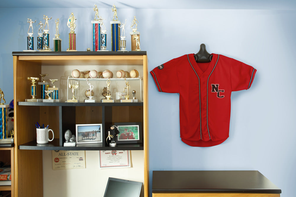 JerseyGenius™ used to hang a jersey to decorate a dorm room