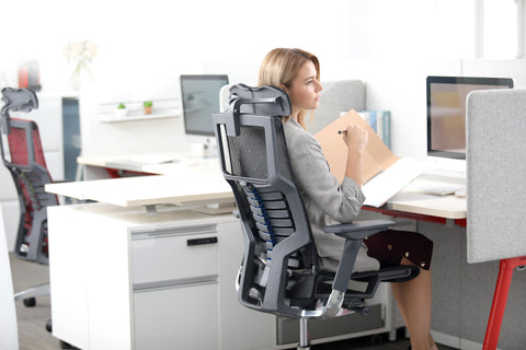 A woman sitting on Pofit chair