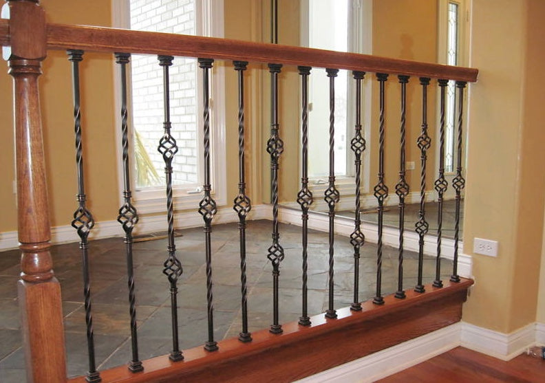 iron balusters shoes; Image: http://splashcarpentry.com