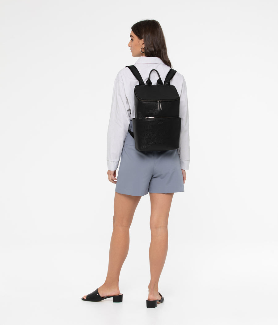 Woman wearing Matt & Nat Brave Backpack in Black