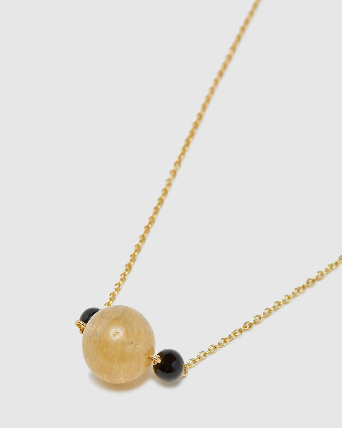 SERINA QUARTZ & ONYX NECKLACE PALE GOLD/QUARTZ/ONYX